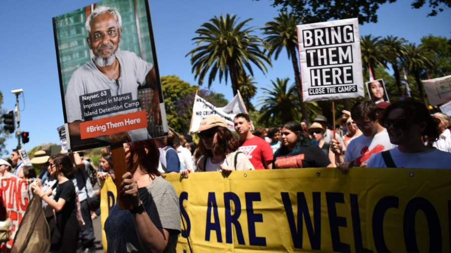 From the cover of the Amnesty report: People march to demand humane treatment of asylum seekers and refugees, in Sydney, November 5, 2016. Photo: Peter Parks/AFP/Getty Images