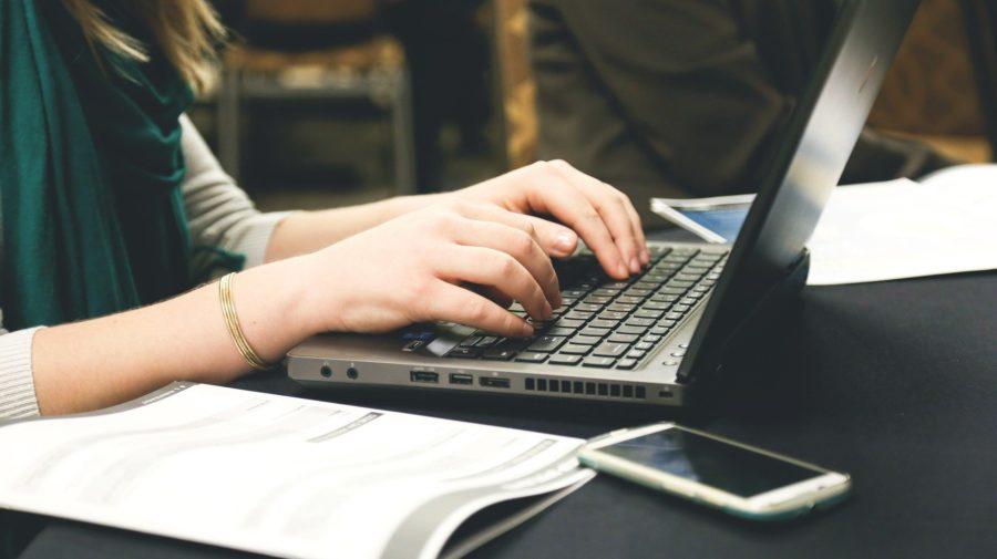 A photo of a person on laptop